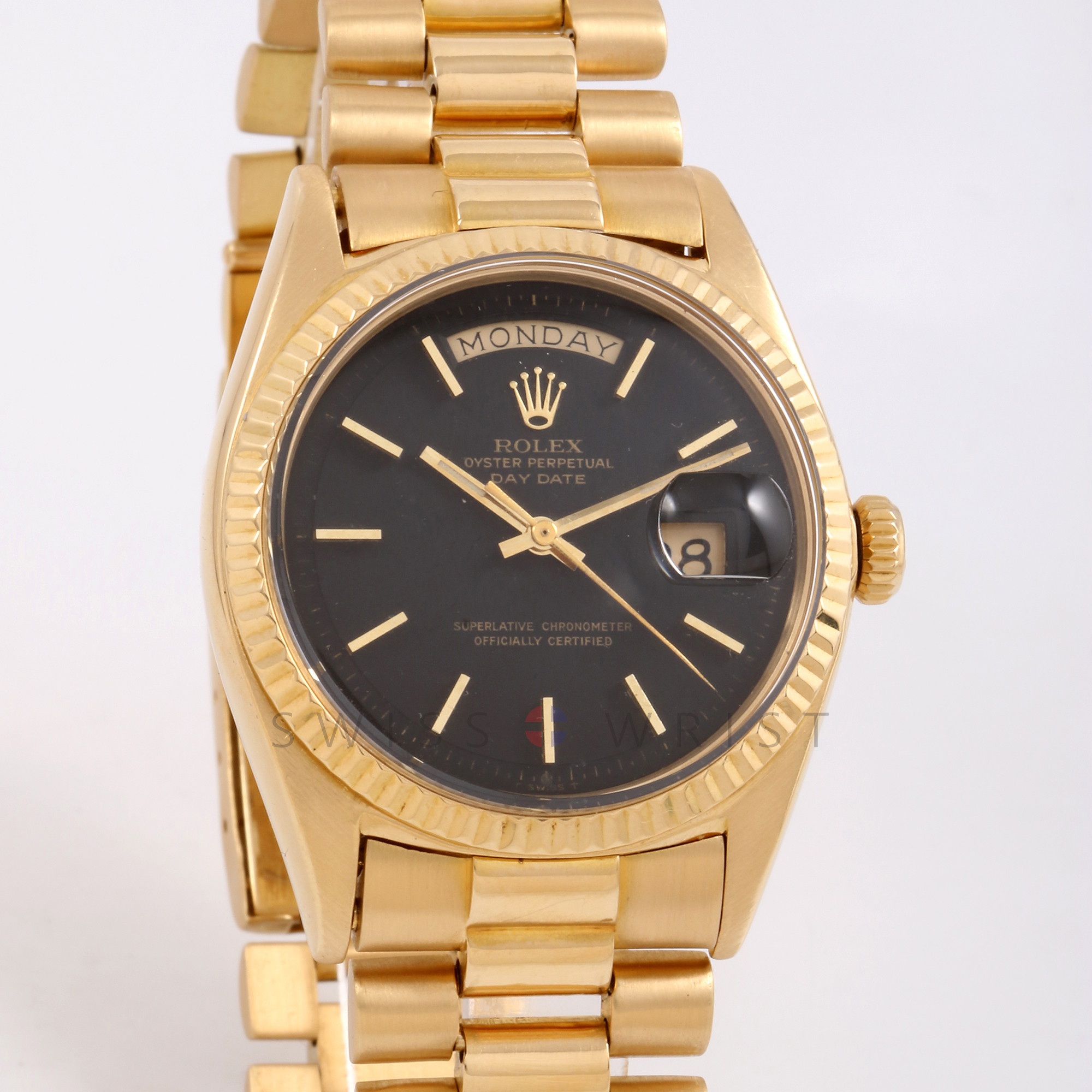 Rolex Day-Date 36 mm 1803 Yellow Gold, Black Stick Dial, Fluted Bezel on a Presidential Bracelet - Pre-Owned Non Quick Set Men's Watch