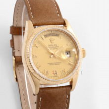 Rolex Day-Date 36 mm 18038 18K Yellow Gold, Champagne Roman Dial, FLuted Bezel on a Tan Leather Strap - Pre-Owned Men's Watch
