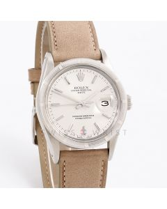 Rolex Oyster Perpetual Date 34 mm 15010 Stainless Steel, Silver Stick Dial w/ Engine Turned Bezel on a Taupe Leather Strap - Men's Pre-Owned Watch