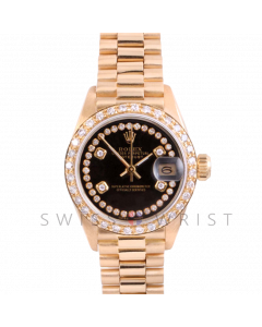Rolex President 6917 Custom Black 4 Stone String Diamond Dial - Yellow Gold - Diamond Bezel On A President Bracelet - Ladies Pre-Owned Watch